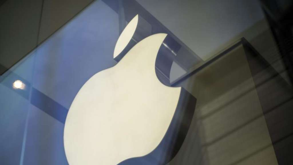 Apple Logo in einem Computer-Laden. Foto: Adrian Bradshaw/Illustration